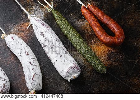 Dry Cured Chorizo And Fuet Salami Sausages  On Dark Background, Flat Lay.