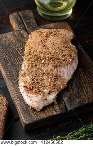 Crumbed Uncooked Chicken Breasts Ingredient,  On Wooden Table