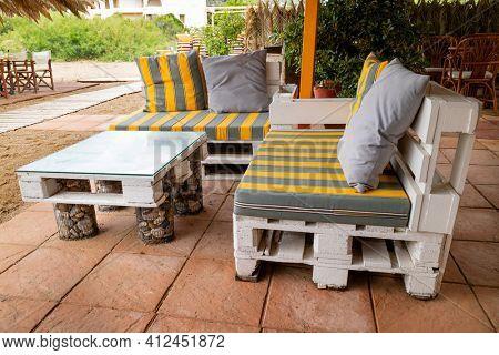 Homemade pallet furniture in the garden in summer