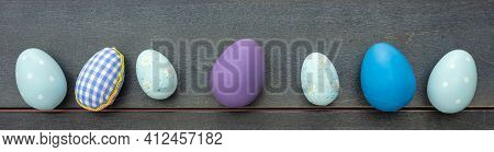 Happy Easter. Blue Pastel Color Eggs Variety On Blue Wooden Background