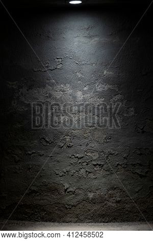 Dark Room Wall With Ceiling Light Background. Old, Weathered Cement And Stone Grey Wall With Peeled