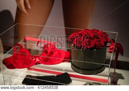 Women's Red Underwear With Roses In Showcase Through Store Window. Women's Fashion Shop Display. Bea