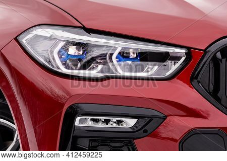 Front Light Of A New Red Car