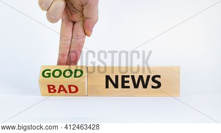 Good Or Bad News Concept. Businessman Turns A Block And Changes Words 'bad News' To 'good News'. Bea