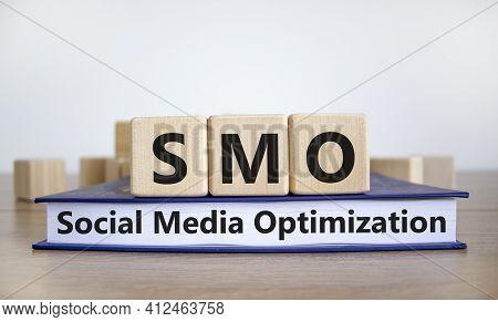 Smo, Social Media Optimization Symbol. Wooden Cubes On Book With Word 'smo - Social Media Optimizati