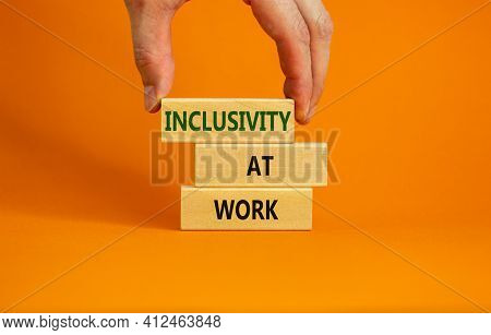 Inclusivity At Work Symbol. Wooden Blocks With Words 'inclusivity At Work' On Beautiful Orange Backg