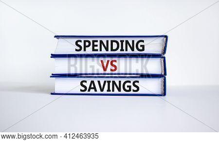 Spending Vs Savings Strategy Symbol. Books With Words 'spending Vs Savings'. Beautiful White Backgro