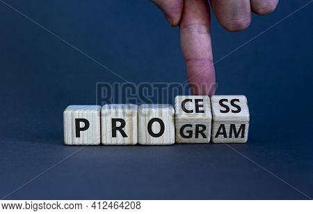 Process And Program Symbol. Businessman Turns Wooden Cubes And Changes The Word 'program' To 'proces
