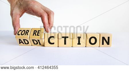 Correction Addiction Symbol. Businessman Turns Wooden Cubes And Changes The Word 'addiction' To 'cor