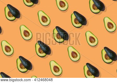 Avocado Trendy  Pattern On Orange  Background, Top View.