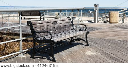 A Park Bench With A Dedicated Name Plate On The Boardwalk At Sunken Meadow State Park On A Sunny Mar