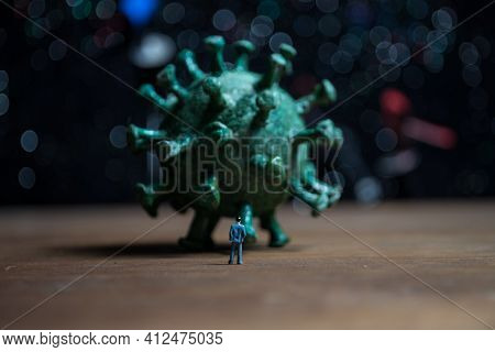 Defocused Businessman Standing With Corona Virus Or Covid19 In Cloudy Background, Corona Virus Pande