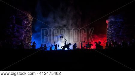Medieval Battle Scene. Silhouettes Of Figures As Separate Objects, Fight Between Warriors At Night.