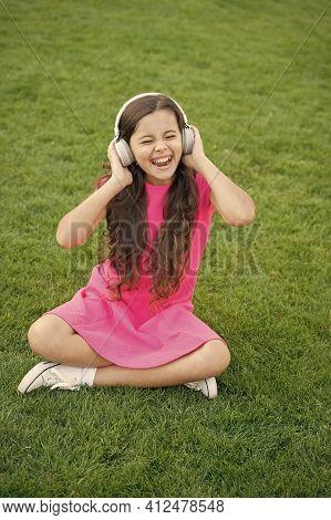 Schoolgirl Enjoy Melody. Listen Music Relaxing Outdoors. Kid Girl Enjoy Music Green Grass Meadow. Pl