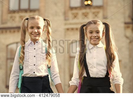 Friendship Is Learning Together. Happy Children Back To School. Little Friends Hold Hands Outdoors.