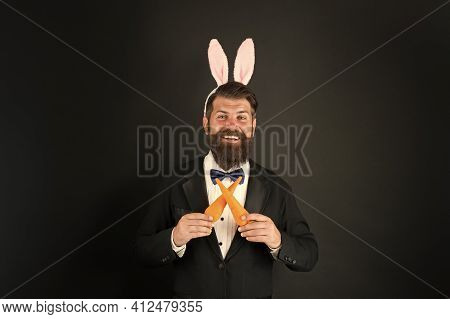 Carrot Is Always Good Idea. Easter Rabbit Black Background. Bearded Man Hold Carrots. Happy Business