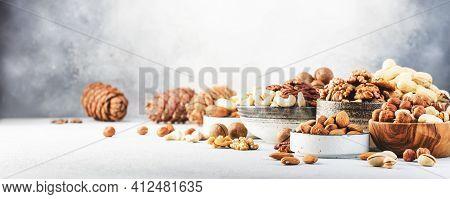 Assortment Of Nuts In Bowls. Cashews, Hazelnuts, Walnuts, Pistachios, Pecans, Pine Nuts, Peanuts, Ma
