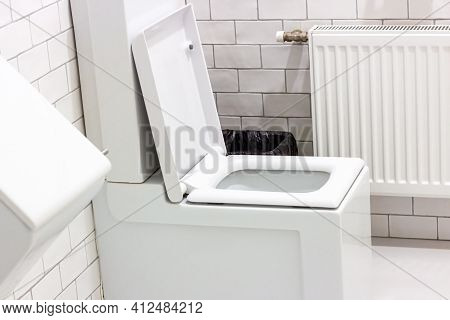 Clean White Ceramic Toilet In The Lavatory.