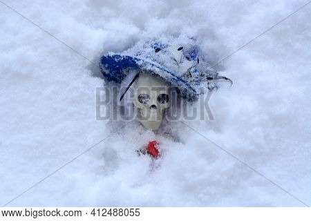 Woman Skeleton In Fancy Blue Hat Buried In Snow During Storm Blizzard