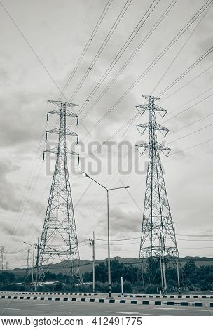Portrait Two High Voltage Tower Or High Voltage Post Beside The Road And Sky Background With Natural