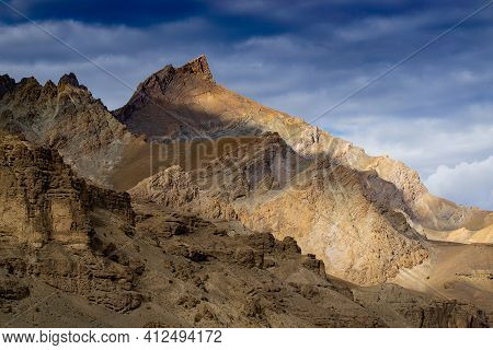Rocky Himalayan Mountian Landscape Of Kargil With Blue Cloudy Sky In Background , Green Valley , Lad