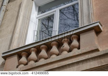 Red Wall, White Window, Balustrade. The Facade Of The Old Building. View From Below Upwards. Spring,