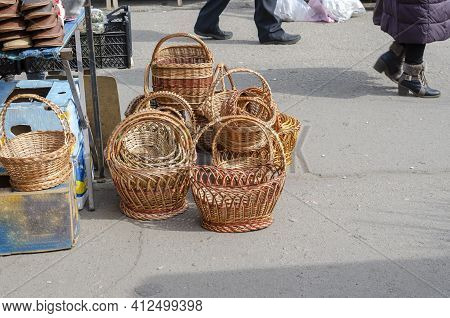 New Wicker Baskets In The Street Market. Easter Or Picnic Baskets. Wicker Products. Spring Fair. Sel