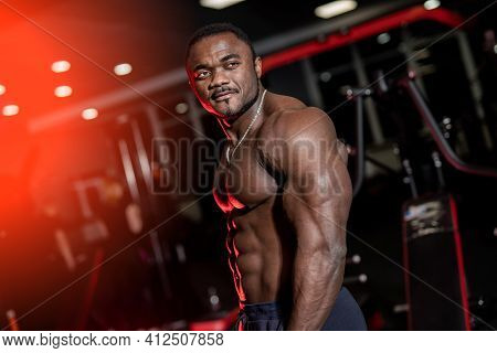 Athletic Body. Shirtless Model Guy Is Posing To The Camera. Strong Muscular African American Man Wit