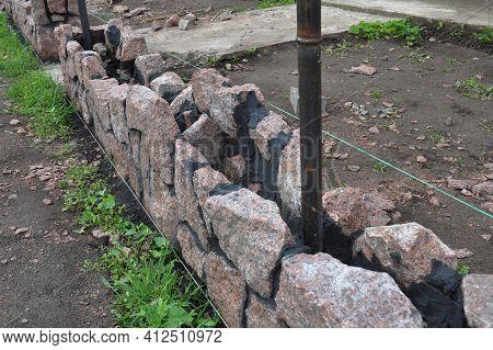 Brick Fence Construction And Stone Masonry: A Close-up On The Construction Of A Stone Fence Foundati