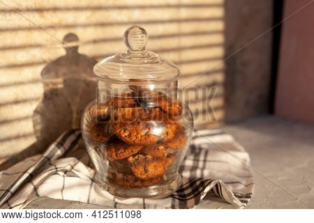 Homemade Oatmeal Wholemeal Crunchy Cookies With Tasty Chocolate Chip In Glass Jar