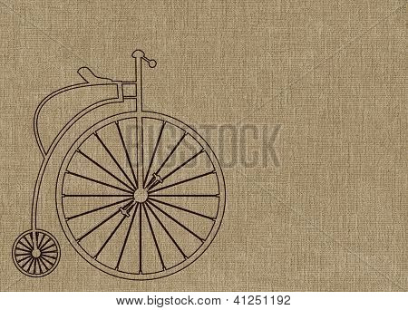 Penny Farthing bicycle on brown textured background.