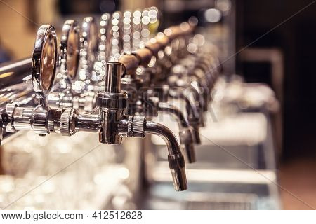 Broad Variety Of Draft Beer Pipes In A Pub Ready For Serving Beer.