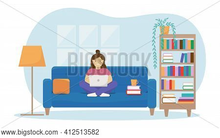 Woman Working Or Studying From Home. Home Office Concept With Sofa, Bookcase, Lamp, Books.