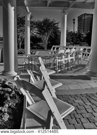 Empty Summerhouse With Wite Chairs Before Wedding Ceremony