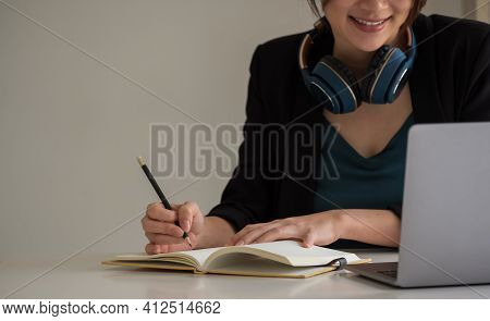 Young Asian Woman Student E Learning Watching Video Training Course Sit At Home Office Desk. Girl Lo