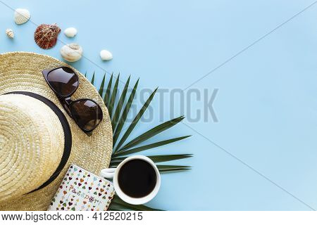 Travel, Vacation Concept. Sea Shells On Sand And Blue Background. Travelling, Trip. Travel Text. Hig