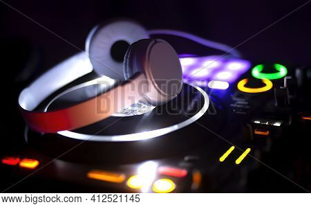 Music Console And Headphones For Dj. Dj Console For Experiments With Music