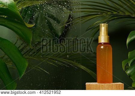 Facial Serum Fluid Cosmetic Oil In The Bottle With Freshness Green Tropical Leaves And Water Drops O