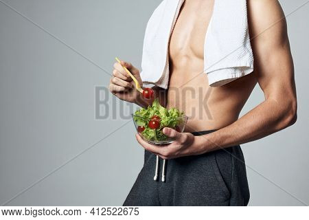 Man With White Towel On His Shoulders Pumped Up Torso Carioca Salad Close-up Workout