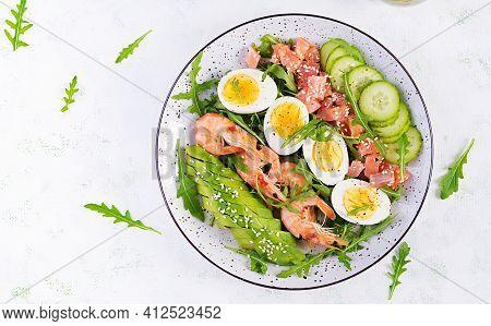 Ketogenic Diet Breakfast. Salt Salmon Salad With Boiled Shrimps, Prawns, Cucumbers, Arugula, Eggs An