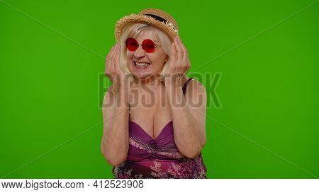 Amusing Funny Mature Woman Tourist In Swimsuit, Fooling Around Making Stupid Brainless Expression