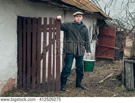 Man In Village With Bucket Of Water Hard Work In The Village