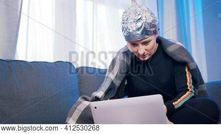 Young Woman With Aluminum Hat Reacting Badly On The Conspiracy Theory Post About 5g Microwaves And C