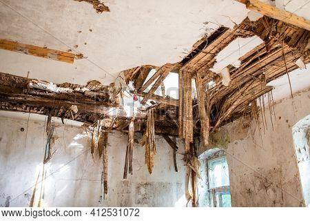 Old Ruined Laths On Broken Ceiling Roof Of A Abandoned House