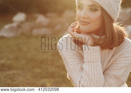 Natural Beauty Attractive Cute Young Girl, Portrait In A Warm Sweater In The Park In Early Spring At