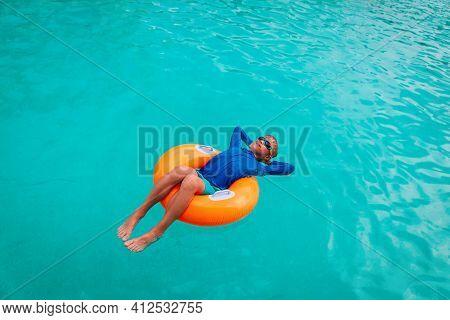 Happy Boy Relax On Floatie In Pool