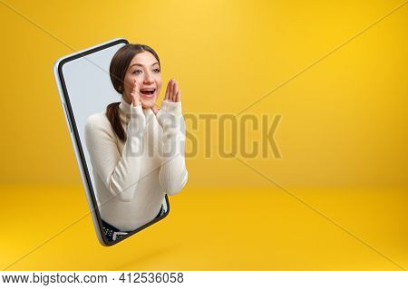 A Beautiful Girl Got Out Of Her Smartphone And Loudly Shouts About The Sale. Young Woman Browsing Th