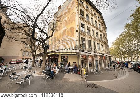 Lyon, France, April 7, 2019: People Sit In A Cafe On The Street In The Historic Center Of Lyon, Fran