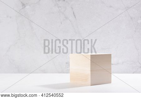 Beige Natural Cube Podium In White And Grey Marble Interior With Sun Light And Shadow. Showcase For