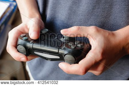 Kyiv, Ukraine - March 03 2021: Sony Playstation 4 Gamepad. Close-up Photo Of A Black Gamepad In The